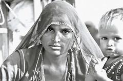 The Mother & Child (me suprakash) Tags: woman india blackwhite pushkar motherandchild rajasthan indianwoman pushkarcamelfair tribalwoman pushkarmela pushkarcattlefair