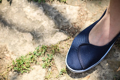 New blue shoes (jtait_CDN) Tags: grass stone foot shoe shoes day outdoor leg ground romania bucharest