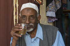 KRN-023 Man Drinking Tea At The Downtown Market, Keren (FO Travel) Tags: africa catholic market muslim islam kultur culture christian mercado afrika tradition markt mercato march cultura keren customs cristiana eritrea afrique chrtien katholisch tradicin costumi cattolica musulman catlica frica  catholique  tradizione christlich musulmn musulmano  muslimisch      rythre  anseba