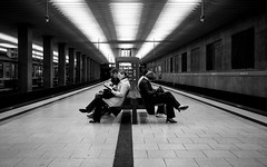 Waiting For The Train (Sven Hein) Tags: people blackandwhite bw station bench subway leute metro candid sony streetphotography bank bahnhof menschen ubahn schwarzweiss waitingforthetrain strassenfotografie rx100m3 rx100iii