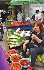 Market colors (stevelamb007) Tags: china woman vegetables nikon suzhou market strawberries streetscene vendor nikkor18200mm stevelamb d7200