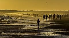 Time Spectra (Watch your back) (Ignacio M. Jimnez) Tags: sunset sea people espaa seascape beach atardecer mar spain sand gente huelva playa paisaje andalucia arena andalusia puntaumbria espectros timespectra