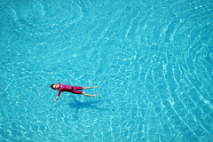 Floating in the pool - Fujifilm X100T (polybazze) Tags: pink boy red summer vacation water pool swimming happy mediterranean fuji child turquoise cyprus floating happiness swimmingpool fujifilm figtreebay x100t