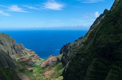 A canyon view with a distant helicopter (Lena and Igor) Tags: kauai hawaii usa us travel canyon rocks mountains slopes ocean sea blue clouds helicopter chopper scenik valley landscape seascape island shore coast dslr nikon d5300 nikkor 18300 telephoto zoom wow