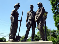The memorial features buff men who died on the job in Indiana. (kennethkonica) Tags: blue usa green leaves lines dedication statue bronze america canon spring workers memorial midwest random outdoor streetlamp indianapolis may hats indy indiana wires buff shovel sculptures global hoosiers canonpowershot marioncounty