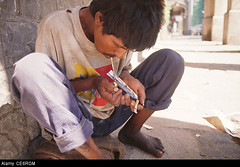 CE6RGM (sophiebradord) Tags: poverty people brown india man color men horizontal effects one clothing adult outdoor side poor young relaxing expressions smoking sugar full health drugs illegal only drug leisure heroin taking simple length hazardous addiction addict chasing injurious dinodia