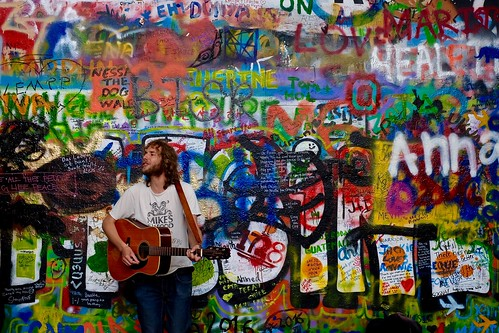 Busker at the Lennon Wall