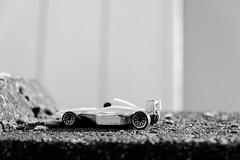 Formula One (John fae Fife) Tags: blackandwhite bw car toy toys belgium noiretblanc joke nb racingcar xe2 fujifilmx