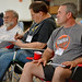 BBQ Camp attendees pay attention to the session on wood and charcoal.