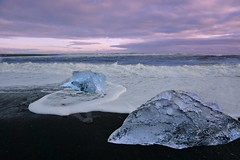 Twirling icy waves foaming on black sand (PsJeremy) Tags: black ice frozen iceland sand ancient wave glacier foam bluehour jokulsarlon blackbeach blueice