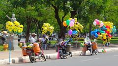 On a street of Phnom Penh (asitrac) Tags: street travel scenery asia cambodia southeastasia character scene phnompenh kh baloons indochina minion streetshop phnompenhdistrict asitrac