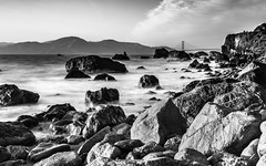 Golden Gate from afar (BiGYaN, ) Tags: ocean sea blackandwhite bw beach water rock rocks pacific pacificocean landsend