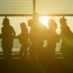 Breakthrough Migration Solutions (Breakthrough Migration Solutions) Tags: travel family blue people italy woman newyork milan roma reflection window silhouette businessman modern backlight walking airplane asian hongkong tokyo losangeles airport women waiting tour adult miami path background interior aircraft escalator transport group flight young silhouettes screen terminal tourist luggage business indoors international lane transportation commute passenger airports sliding baggage