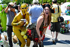 Yellow man with a lady pirate (drpavloff) Tags: mermaid topless mermaidparade brooklyn coneyisland nudeinpublic sexinpublic naked toplessparade girls sexygirls nyc nude naturist party gonewild tattoogirls toplessgirl boobs umbrella sex sexy longhair wig blond hot hotpair bra braless brunette redhead bikini panties mermaids sun summer sky parade nudeparade tits sunglasses bodypainting black blackbeauties hats cowgirls guns highheels jellyfish tattoo girltattoo lady pirate goldmember