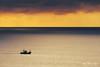 Barco al atardecer (Mimadeo) Tags: ocean sunset red sea sky orange seascape color water beautiful sunrise landscape golden evening boat ship dusk vessel calm fishingship