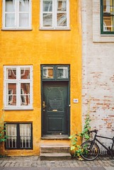 Yellow. (www.juliadavilalampe.com) Tags: street city urban love window bike architecture copenhagen denmark europe lifestyle amarillo stadt danmark