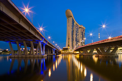 Twin Vanishing Points (Shutter wide shut) Tags: longexposure travel bridge reflections hotel vanishingpoint twilight singapore casino starburst starbursts marinabay tiltshift leadinglines benjaminshearesbridge marinabaysands canoneos5dmarkiii canontse24mmf35lii bayfrontbridge canongpsreceivergpe2