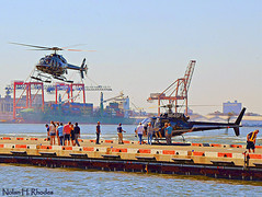 Tourist Flying Machines At Downtown Heliport NYC (nrhodesphotos(the_eye_of_the_moment)) Tags: nyc people woman men metal brooklyn port docks children waterfront bokeh manhattan tourists passengers cranes transportation eastriver machines helicopters pilot blades hovering grounded heliport fumes perpective crewmember cargoship rotos sightseers flyingmachines downtownheliport blinkagain cargodocks dsc7002001