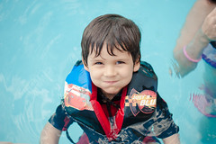 Another big smile! (Daniel A Ruiz) Tags: boy summer portrait water pool smile happy 50mm kid eyes nikon pretty bokeh floating ripples