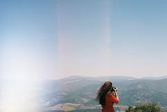 000043 (kirmizidemlik) Tags: camera blue red sky mountain green film girl beautiful analog canon hair photography photo ae1 pic curly canonae1