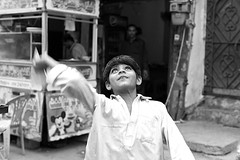 paper planes...the simple pleasures.. (camelot98) Tags: street travel pakistan boy blackandwhite bw blur 50mm movement asia candid streetphotography streetportrait karachi m9 paperplanes urbanarte thephotographyblog vision:outdoor=0743