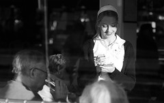 The Cheerful Waitress (Just Ard) Tags: street uk urban bw woman white house man black window coffee girl smile wales photography restaurant nikon order tea candid cymru 85mm lipstick waitress caerphilly caerffili d7000 justard vision:people=099 vision:face=099 vision:outdoor=0676