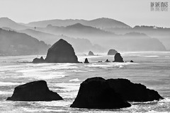 Range Layering (Ian Sane) Tags: ocean park camera white seascape black mountains beach rock oregon canon lens landscape ian photography eos is state pacific images 7d haystack cannon usm range ecola layering sane ef100400mm f4556l