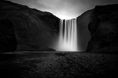 Skógafoss (galac69) Tags: longexposure travel summer sky blackandwhite bw cliff mist mountain slr water monochrome rock misty stone clouds digital photoshop river landscape photography is photo waterfall iceland nikon rocks europe european day cloudy stones south fineart hill smooth landmark cliffs arctic photograph le processing nordic dslr volcanic ísland midnightsun d800 icelandic skógafoss postprocessing skogafoss travelphotography southiceland skógá thefella 10nd conormacneill skógáriver thefellaphotography