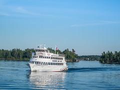 Tourboat On The St. Lawrence (nfRabbit) Tags: sea newyork buildings us unitedstates transportation rivers thousandislands watercraft 1000islands stlawrenceriver tourboat alexandriabay