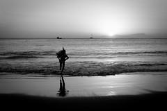 My liquid horizon - Unreachable 7 (Izzy Lara) Tags: ocean light sunset shadow sea blackandwhite bw sun beach kid pacific horizon run shore