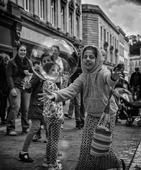 chasing the dream (Daz Smith) Tags: city uk portrait people urban blackandwhite bw streets blancoynegro girl monochrome canon blackwhite bath candid young citylife thecity streetphotography running bubble chase chosen canon6d dazsmith bathstreetphotography