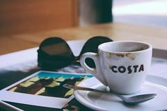 Coffee break (Shahrazad_84) Tags: barcelona stilllife costa cup coffee sunglasses postcard spoon simplicity mug pause caff coffeebreak pedrera gaud