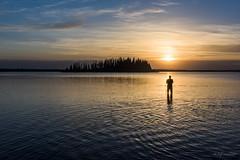 The Photographer (WherezJeff) Tags: sunset lake water silhouette person nationalpark photographer silouette elkisland element astotin
