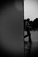 Emerging (stimpsonjake) Tags: city blackandwhite bw woman monochrome silhouette wall walking candid streetphotography highcontrast romania bucharest 185mm nikoncoolpixa