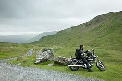 The Lone Rider (Wandering Ilara) Tags: road uk travel mountain green nature fog clouds landscape freedom nikon rocks view hill ngc lakedistrict motorbike biker d90