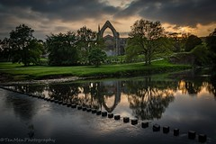 Bolton Abbey at Sunset (jasonmgabriel) Tags: trees sunset reflection building abbey clouds river landscape religious scenery stones yorkshire ruin stepping bolton wharfe