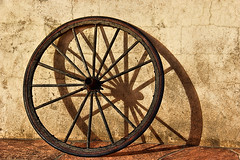 Broken Wheel [in Explore  21 June 2016] (studioferullo) Tags: ranch old light shadow arizona brown abstract texture wheel wall contrast rural circle outdoors town rust pretty pattern shadows village tucson outdoor decay farm country sunny sphere round vehicle minimalism tanqueverde