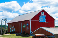 Windmills-Barn Quilt and Steel (Images by MK) Tags: windmill windmillwednesday hww barnquilt quilt red sky blue redbarn sign signage signs farm farmstead rural clouds shadow wisconsin wi architecture building outdoor kingedwardcigars 76 burgerking kingedwardscigars johndeere deere national food nationalfoodstores