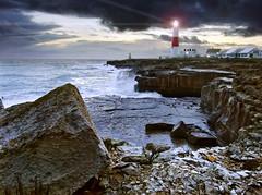 Portland Bill (Beardy Vulcan) Tags: winter sunset sea england lighthouse storm night portland coast twilight rocks waves january dorset obelisk bluehour headland portlandbill 2013 raisedbeach
