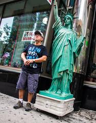 Meet Me at the Statue (John Skelson) Tags: nyc newyorkcity nikon unitedstates manhattan streetphotography timessquare streetscenes midtownmanhattan d600 artlab nikond600 newyorkcitystreetphotography johnskelson nikon28300mmlens timessquareartlabmanshoot2013 artlabstreetphotography