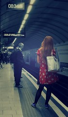 Another day begins (mttbrnby) Tags: travel people woman man travelling london station lady train underground waiting candid tube platform kingscross reddress selective colourpop flickrandroidapp:filter=none