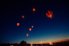 Fly Me to the Sun (Alex Zhu | Photography) Tags: show blue light color night race sunrise dark dawn colorful glow lift darkness nevada hotair balloon liftoff reno rise patrol
