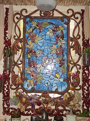Wrought Iron Stained Glass Window (Stained Glass Addie) Tags: italy wine wroughtiron stainedglass tuscany grapes grapeleaves grapevine chickadees grapeleaf