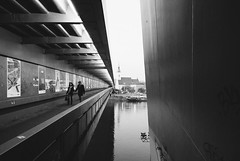 ..>\ (petrdusek) Tags: street city bridge light urban blackandwhite bw black water lines architecture river concrete lights nikon geometry steel symmetry slovakia v1 bratislava emulation 10mm vsco