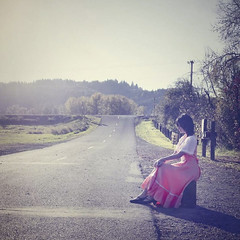 Runaway Dream (Mya and the Glittering Withywindle) Tags: travel bus art girl vintage photography waiting shoot sitting dress fine stop theme 50s conceptual suitcase runawaydream soumyajayaraman