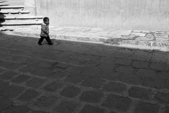 little strides in a big world.. (camelot98.) Tags: street leica city travel light boy urban bw blanco lines contrast children child bright candid patterns negro streetphotography sunny monochromatic minimal mexican minimalistic