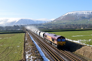 66238 winds its way through the Vale of Edale with the 6E51 peak Forest to Selby loaded limestone, 10th Feb 2015.