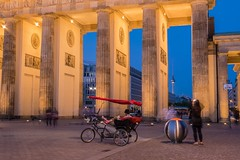 Waiting in front of the gate (alxfink) Tags: light red berlin architecture night lumix gate brandenburggate column bluehour rickshaw