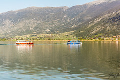 Boats (Thomaskont) Tags: lake nature water landscape boat nikon outdoor hill greece mountainside ioannina epirus d5200 warercourse