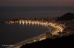 Copacabana vista do Po de Acar (Ivan Costa) Tags: brazil mountain sol praia beach rio brasil riodejaneiro rj janeiro dusk sugar copacabana pao loaf seen por montanha forte acucar entardecer